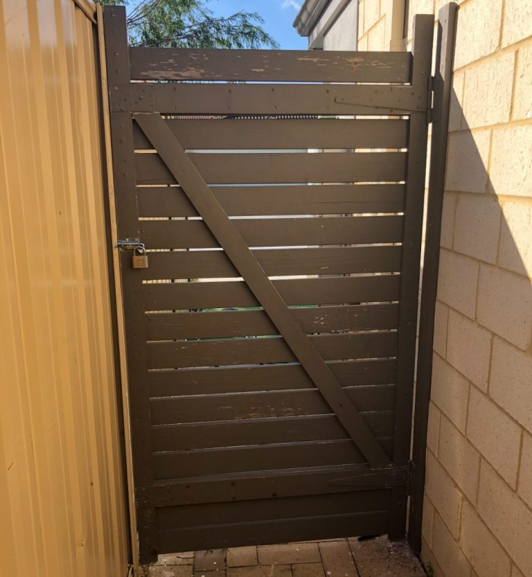Secured side gate at house.