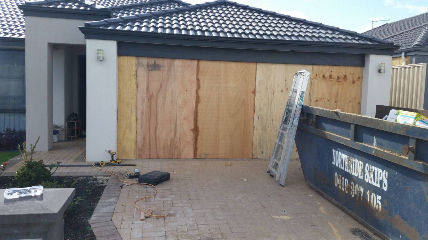 Garage with a temporary repair after a crash.