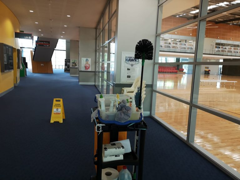 Sports centre cleaning in progress.