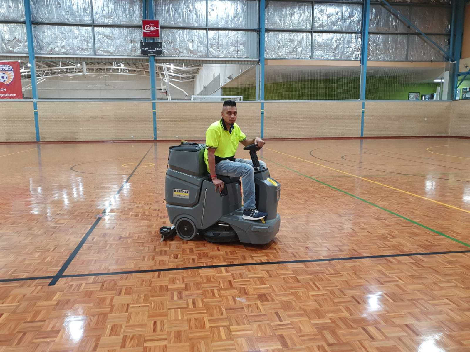 The team cleaning a sports centre.