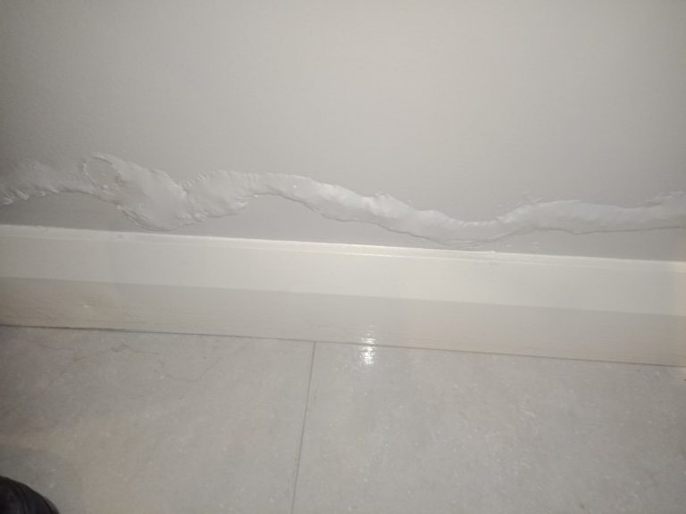 Water damage to a wall.